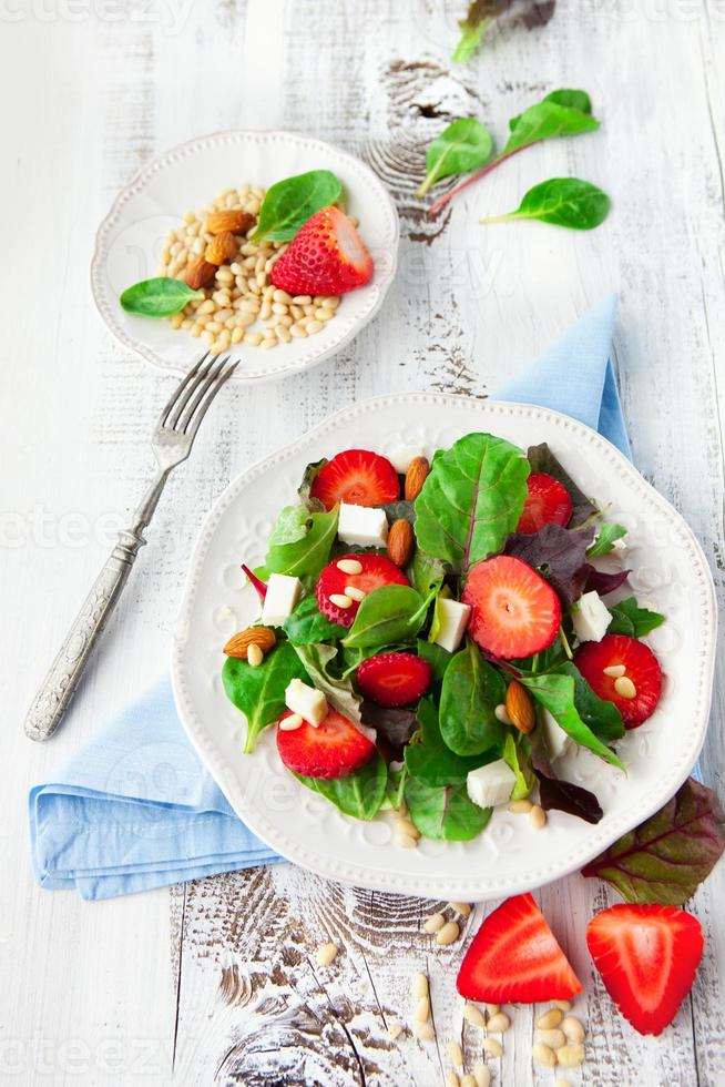 Spring salad with spinach leaves photo