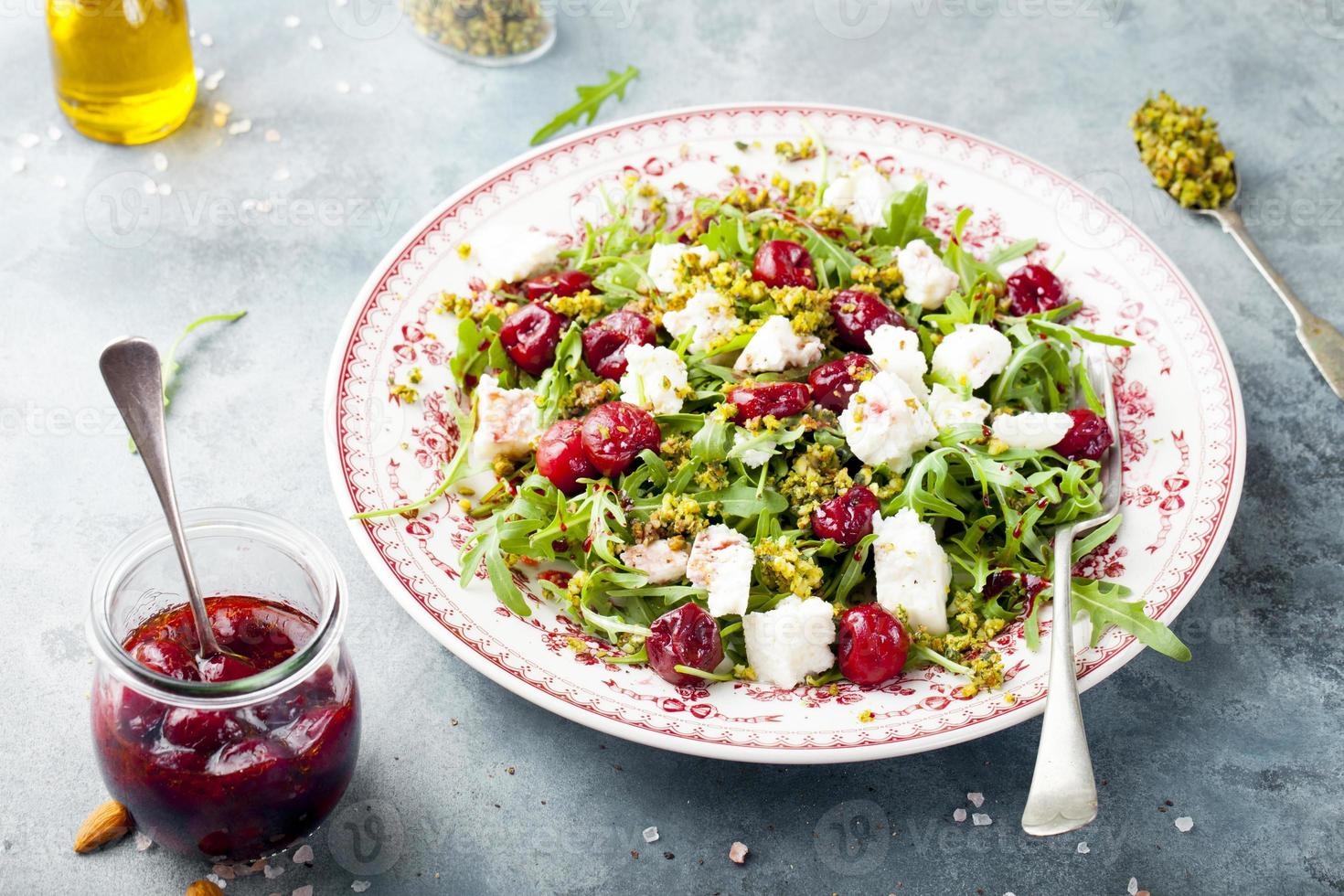 Salad with arugula, cherries and goat cheese. photo