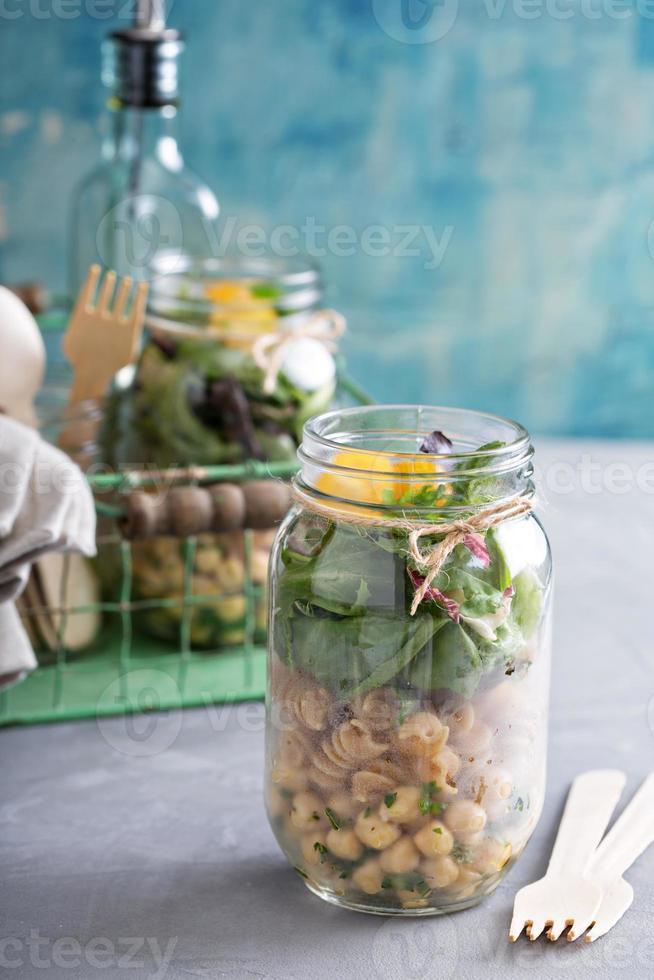 Assembling a mason jar salad photo