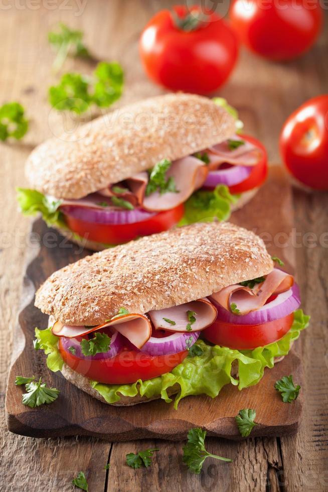 ham sandwich with tomato onion lettuce photo