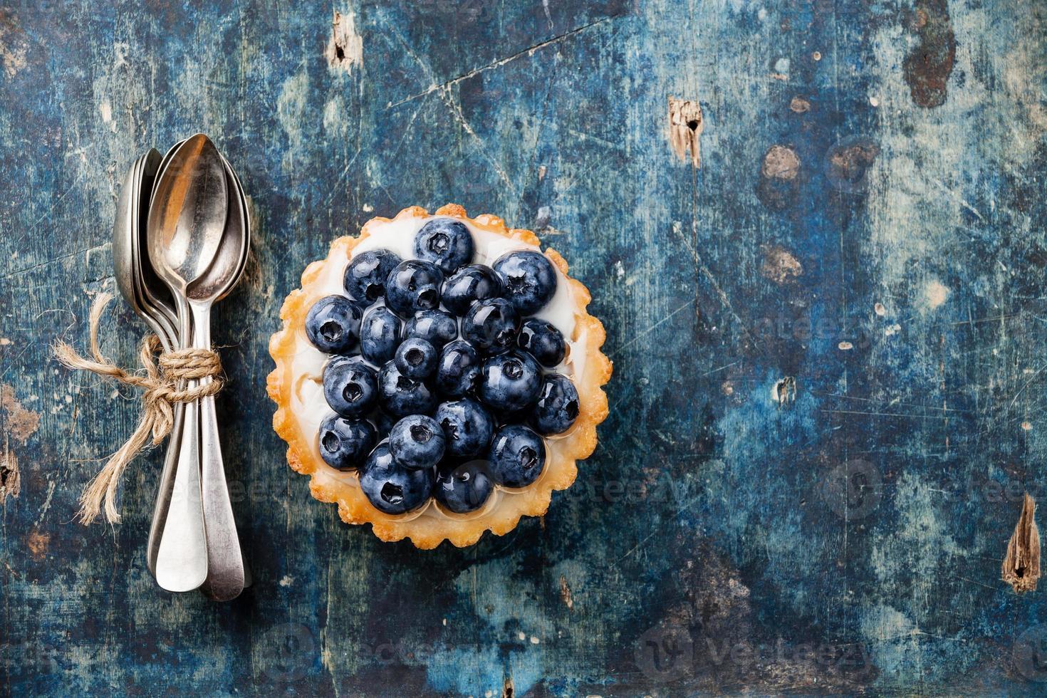 Blueberry tart and teaspoons photo