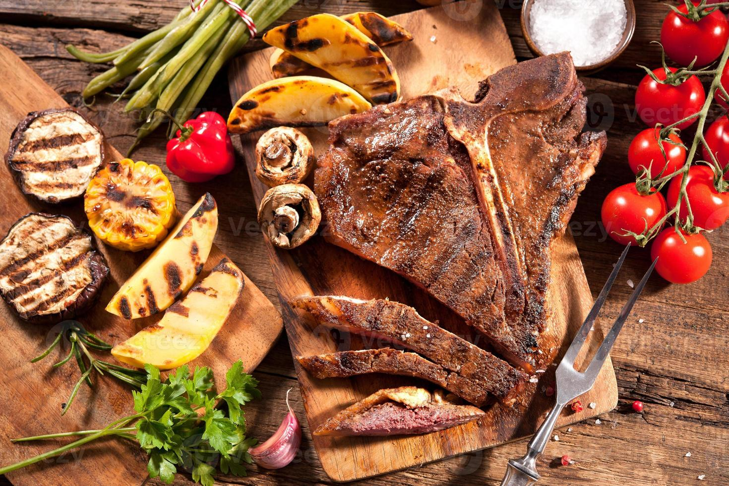 Beef steaks with grilled vegetables photo