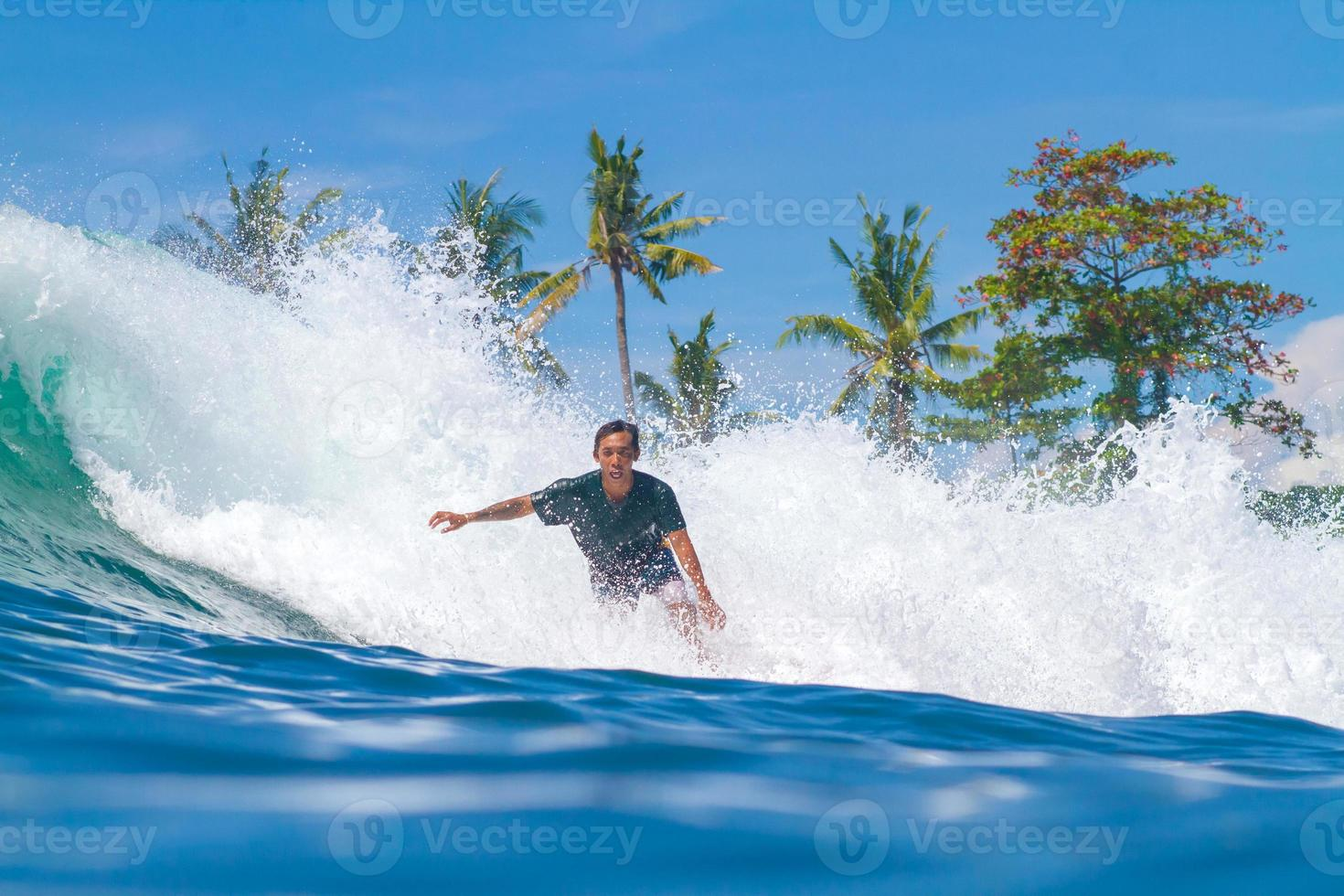 Surfing a Wave. Bali Island. Indonesia. photo
