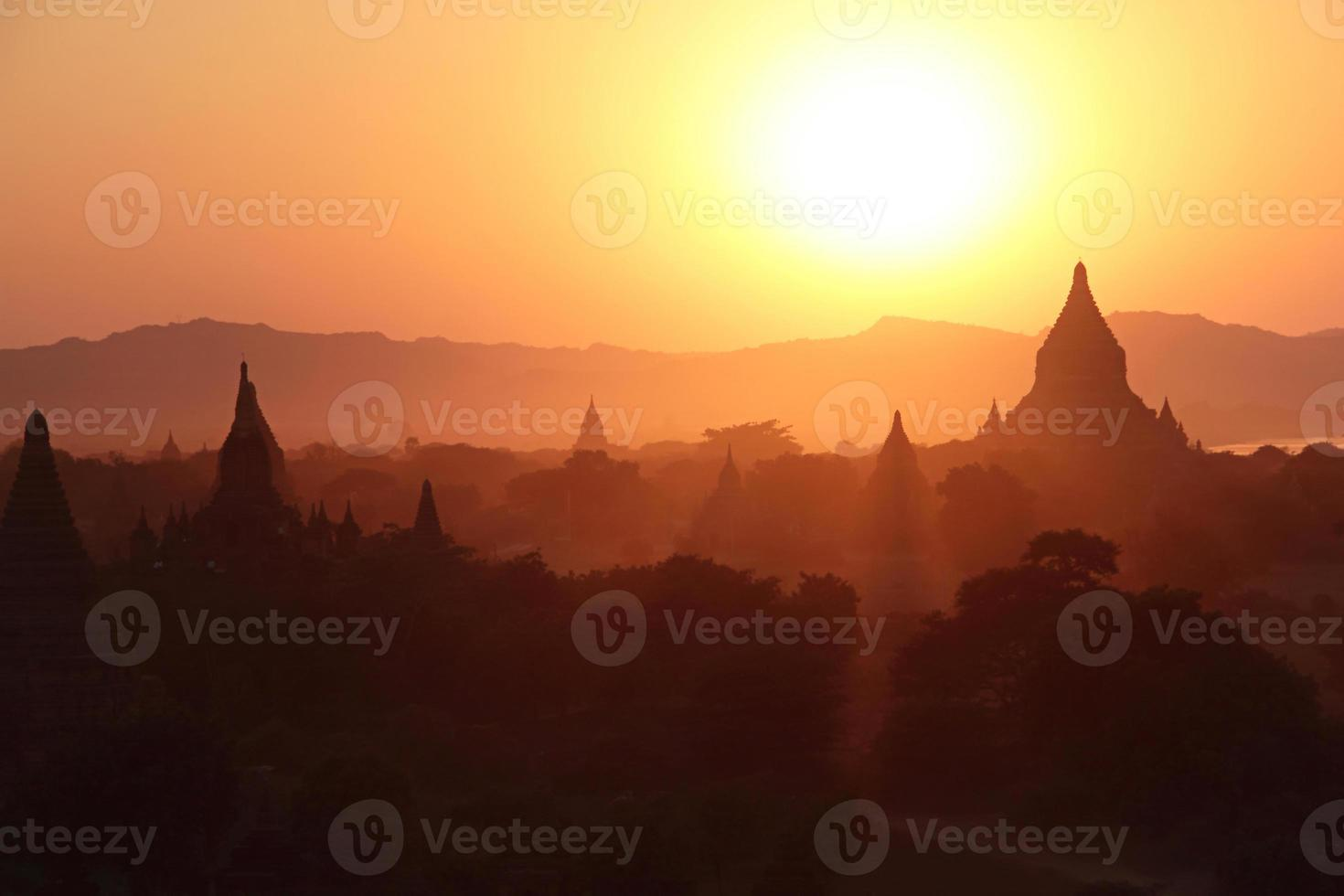 silhouettes of ancient Buddhist Temples photo