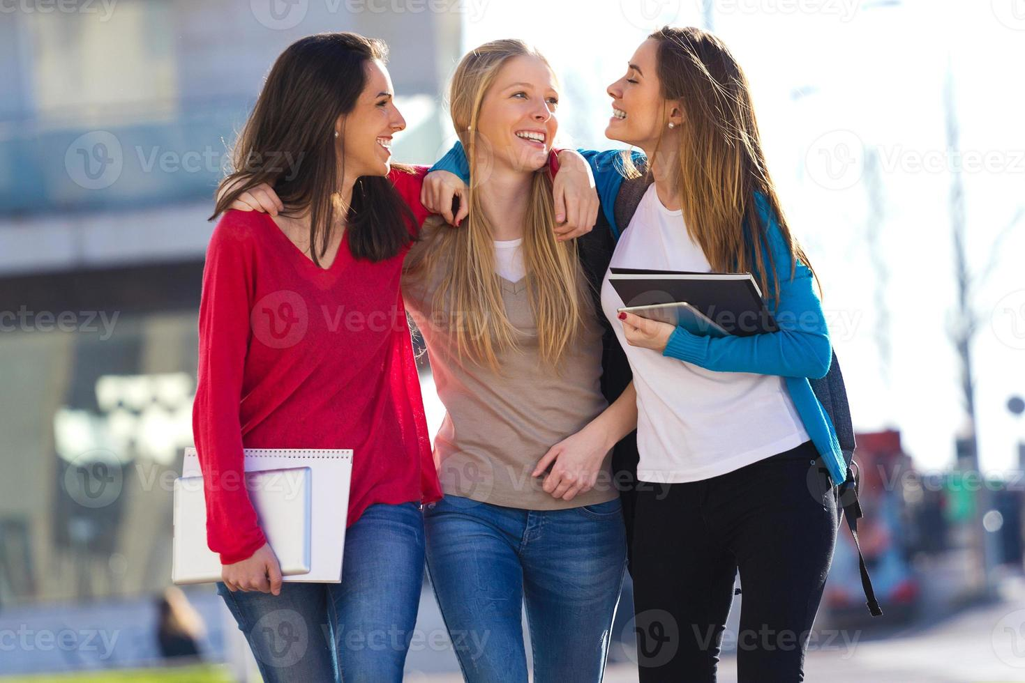 Friends talking in the street after class photo