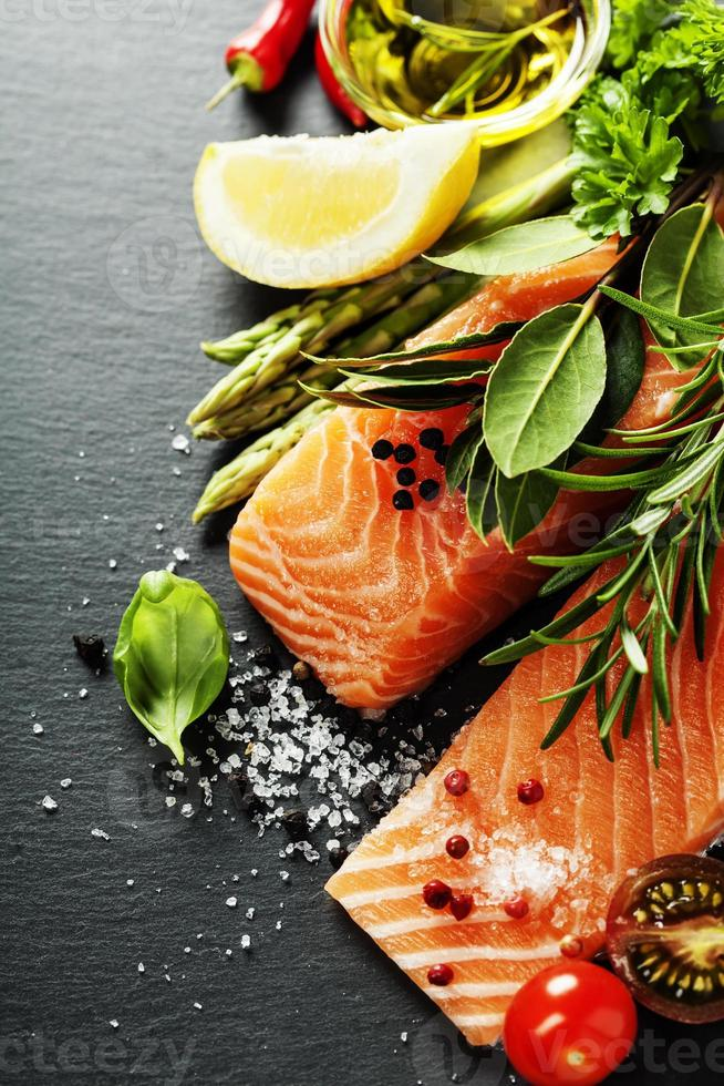 Delicious  portion of  fresh salmon fillet  with aromatic herbs, photo