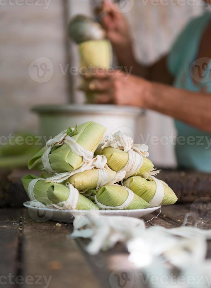 Woman making tamales in Cuba photo