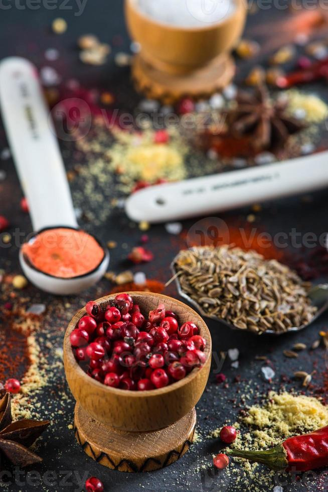 Spice selection from all around the world, on black background photo