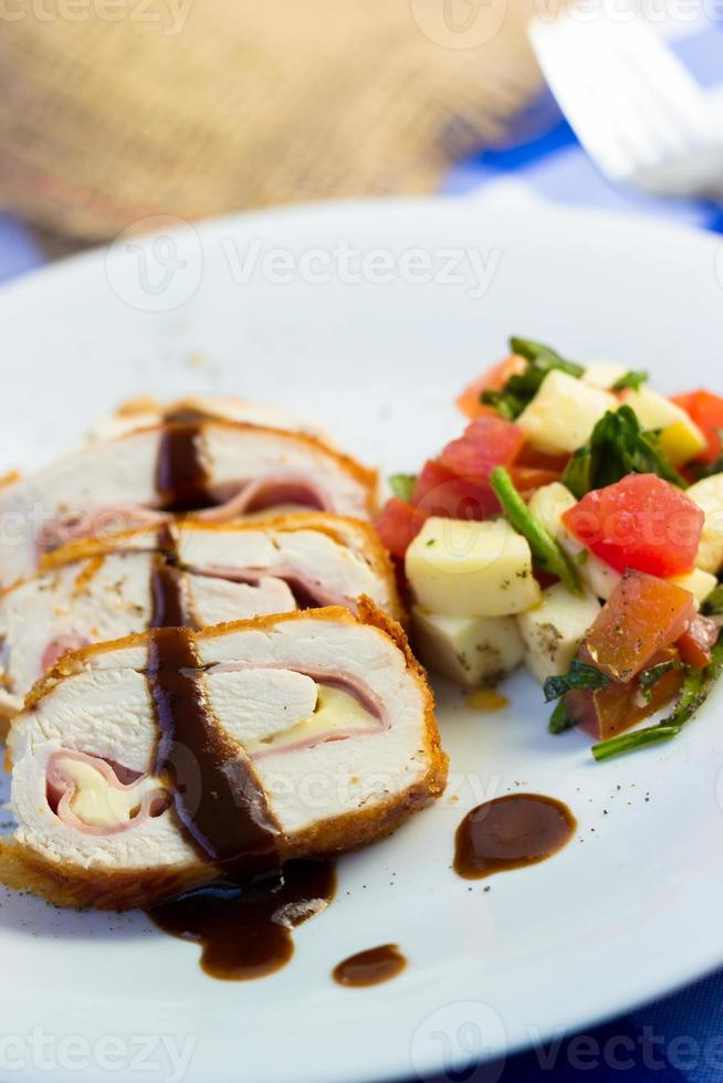 Grilled chicken Cordon Bleu meat and vegetables photo