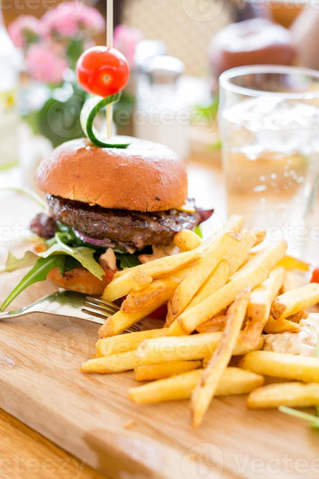 Hamburger with french fries. photo