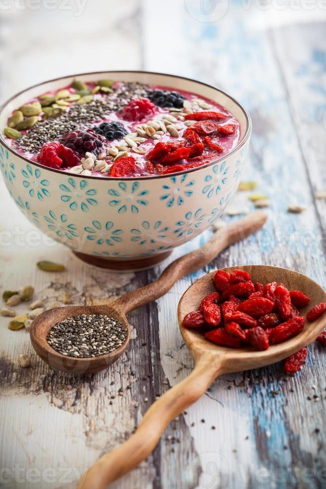 A berry and grains smoothie bowl for breakfast photo