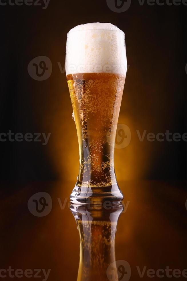 Glass of light beer photo