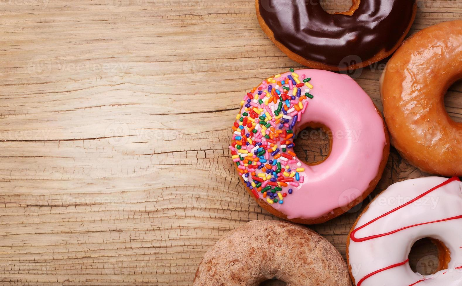 Donuts on wooden background photo
