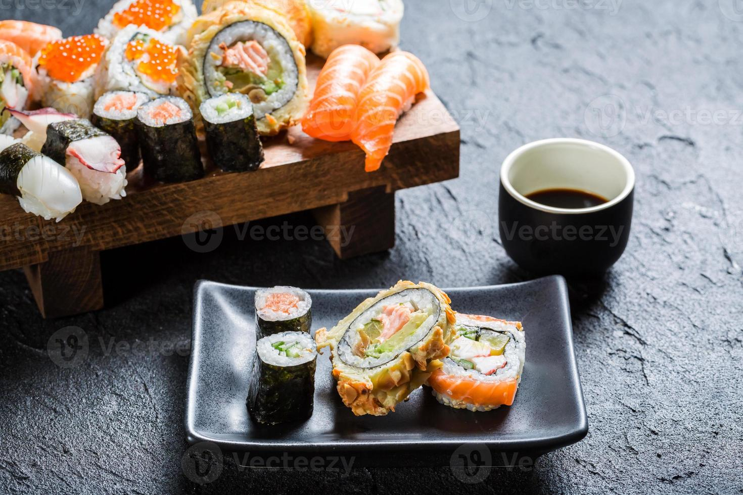 Sushi with soy sauce on black stone photo
