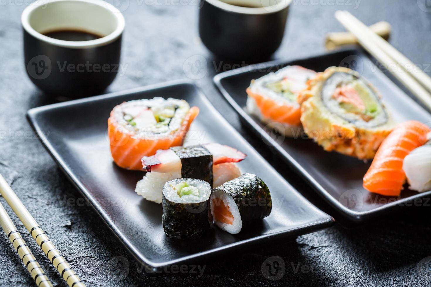Sushi served with soy sauce for two photo