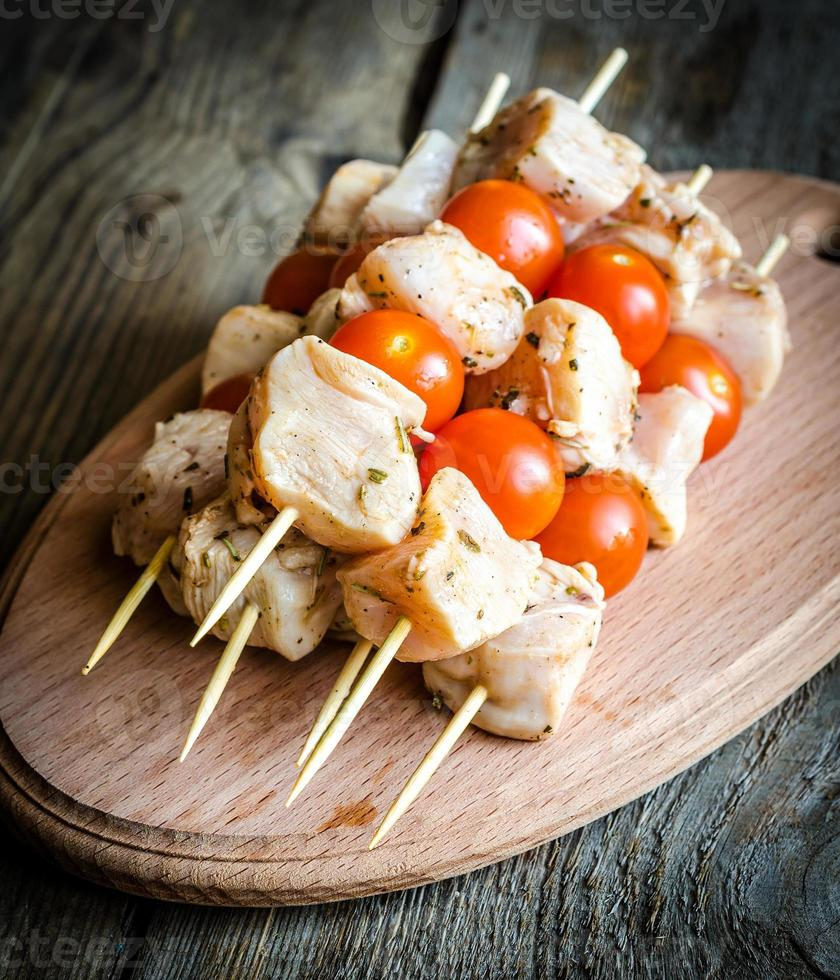Chicken skewers with cherry tomatoes photo