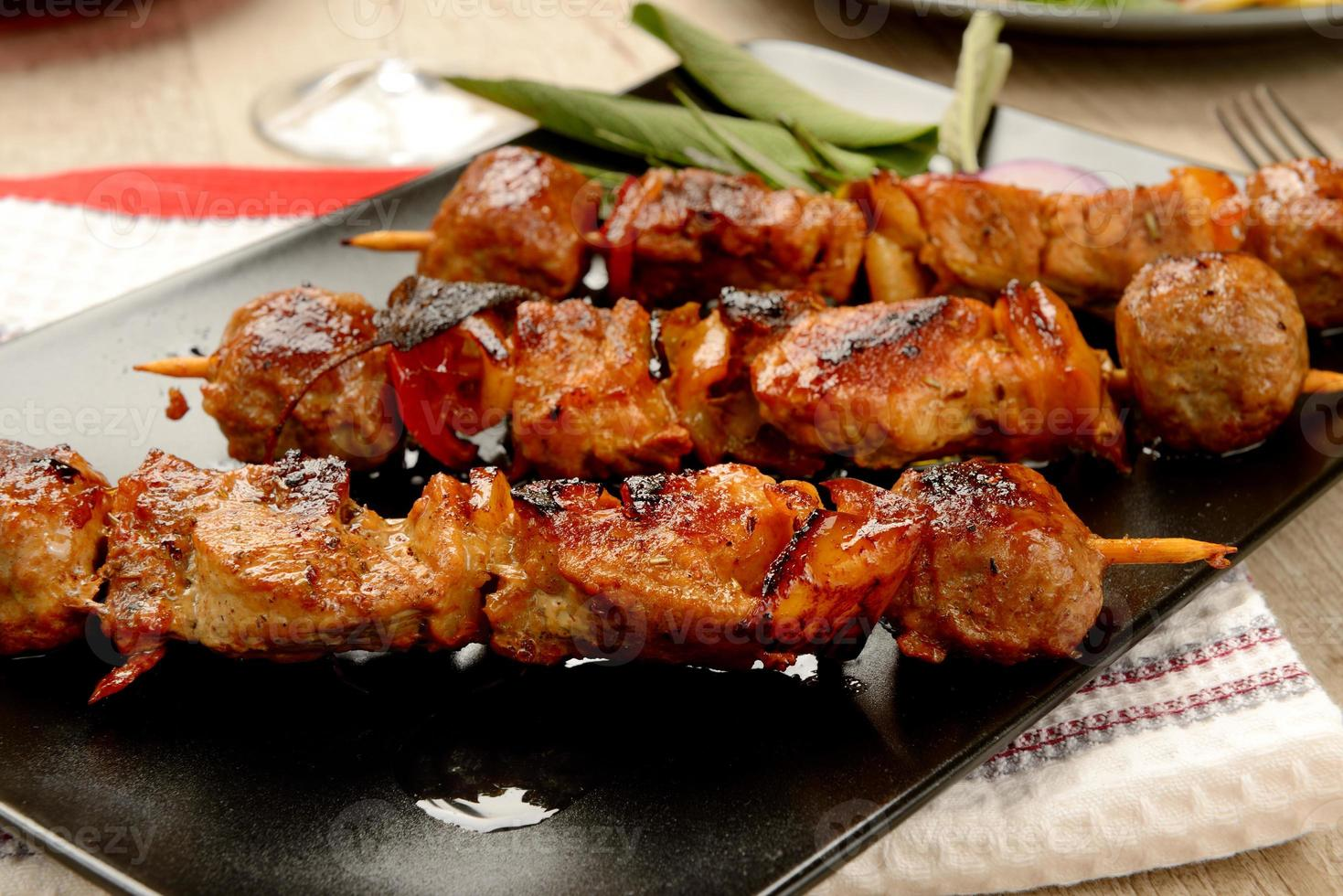 Skewers of meat cooked ready to eat photo