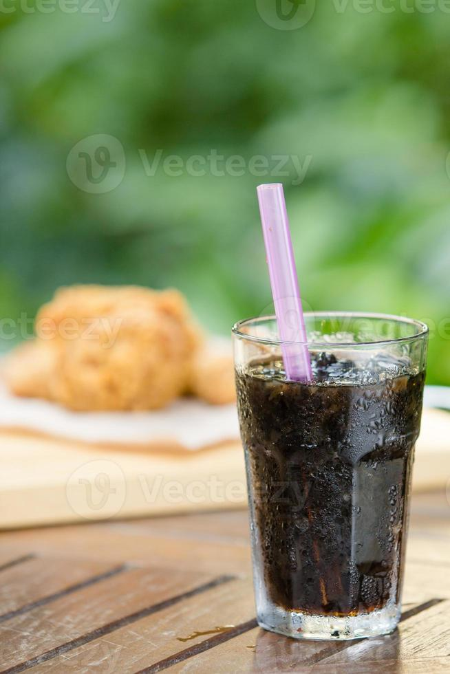 glass of cola with ice photo