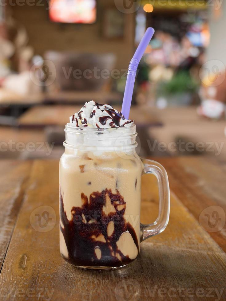 Ice coffee on a wooden table in a coffee shop photo