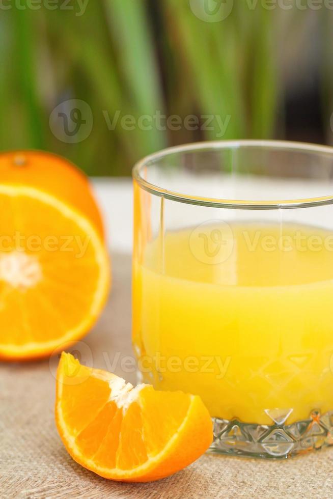 Fresh oranges and orange juice photo