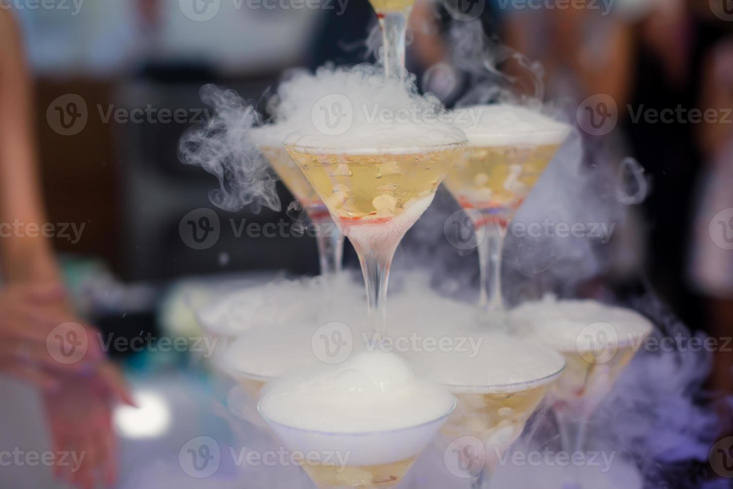 Line of different coloured alcohol cocktails on event open-air party photo