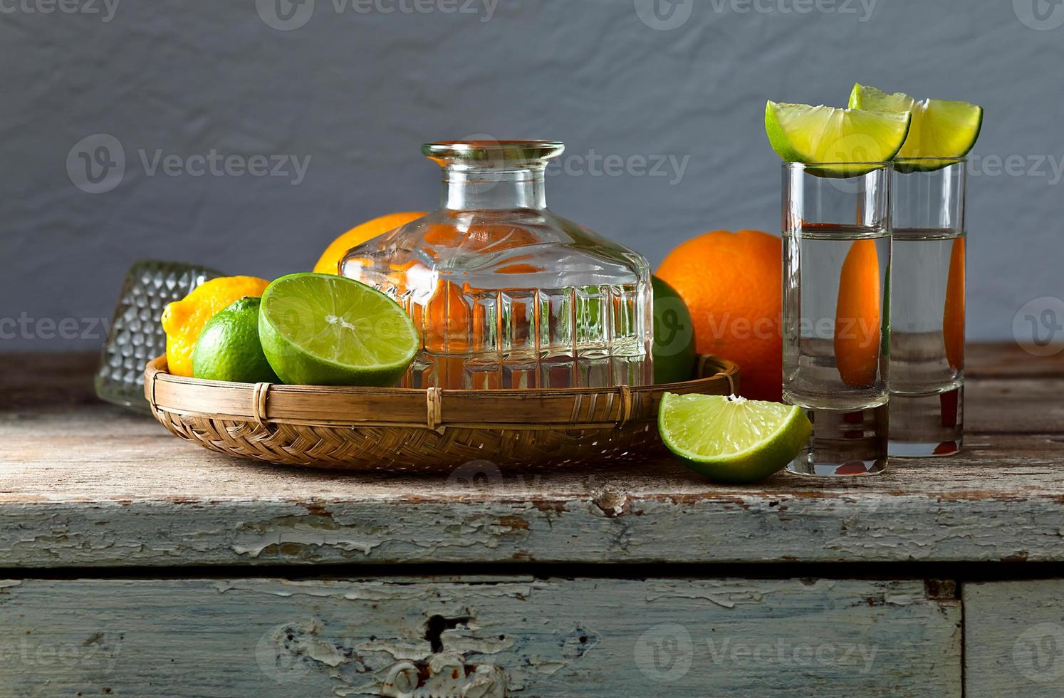 tequila and citrus fruits photo