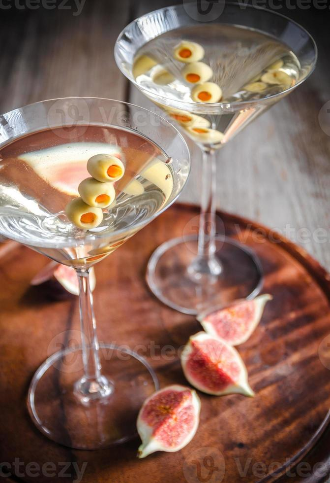 Two olive martini cocktails photo