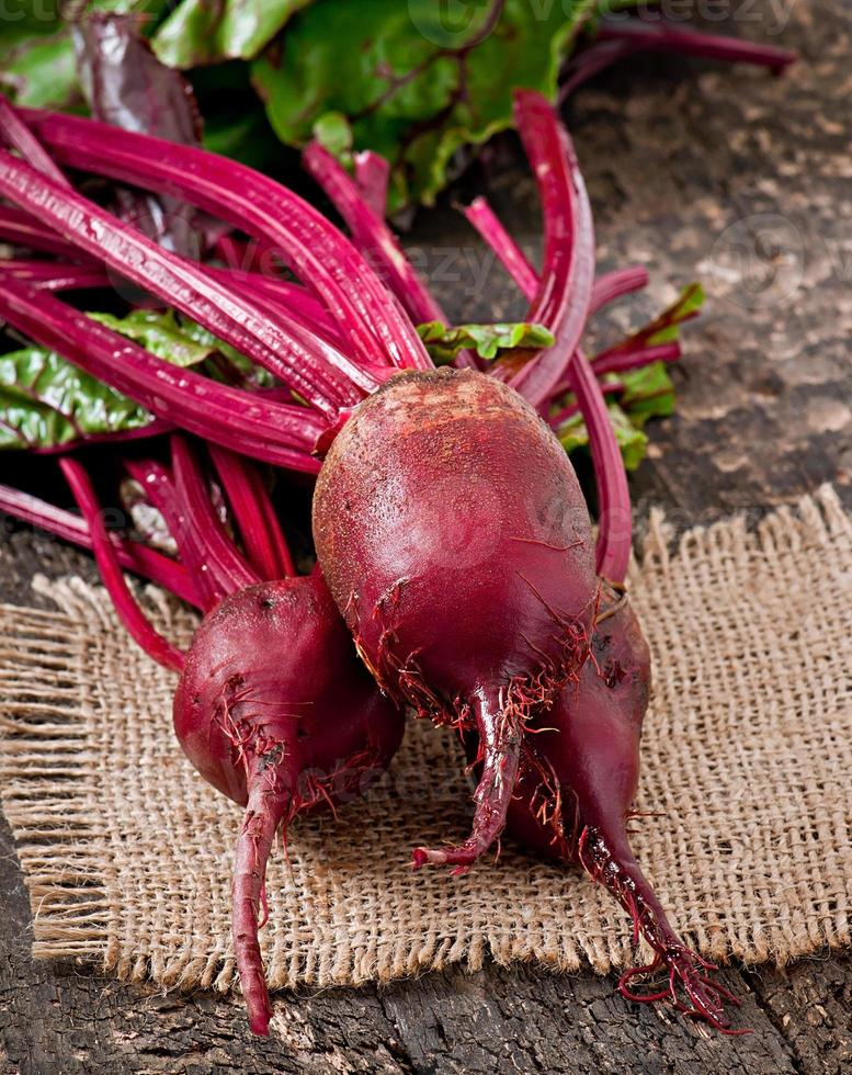 Beetroots on wooden background photo