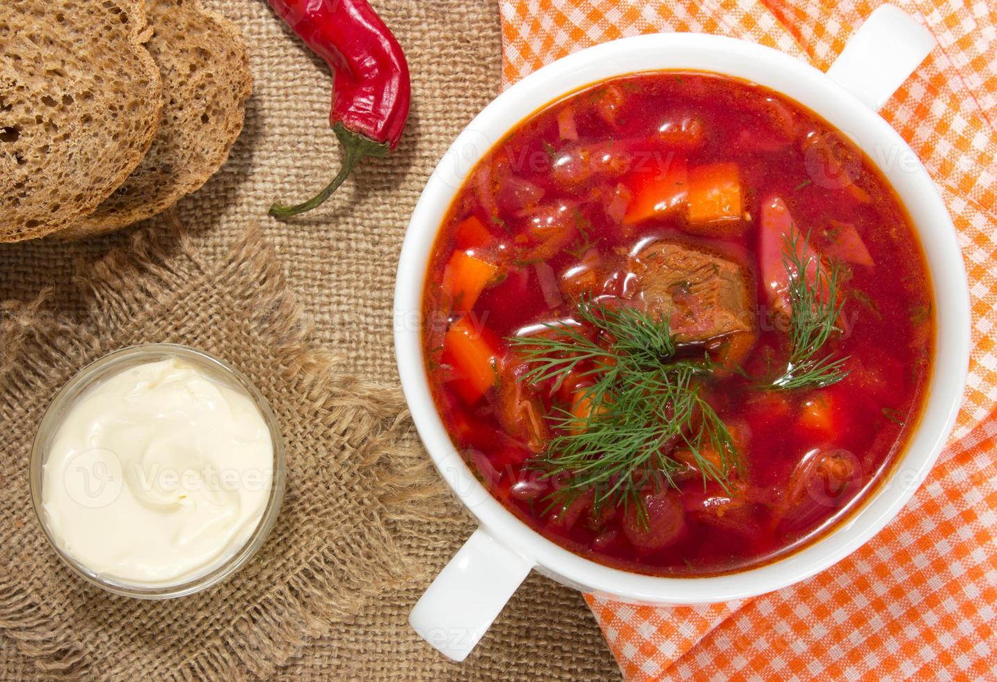 Borsch in white bowl . Red beetroot traditional soup. photo