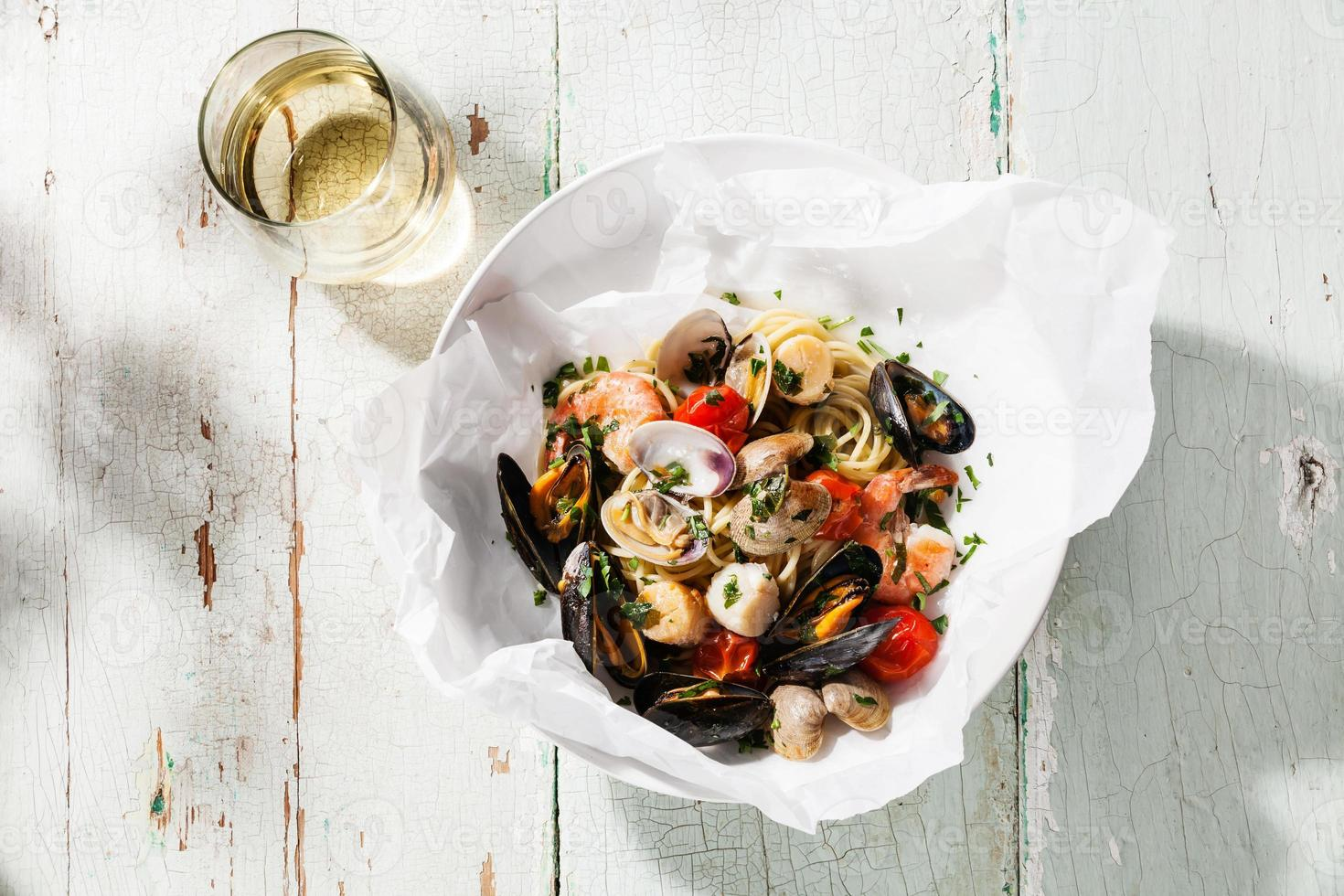 Seafood pasta and wine photo