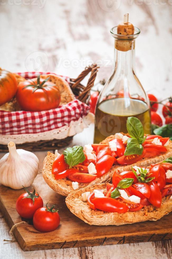 Italian starter, bruschetta with Sicilian red fresh tomato and m photo