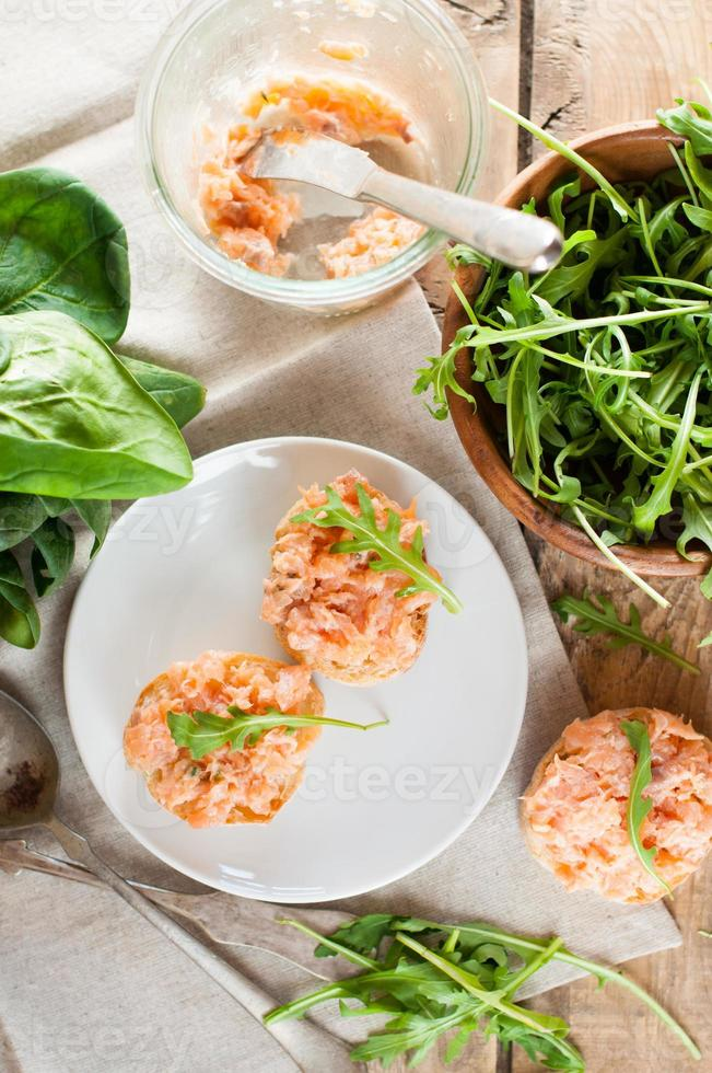 sandwiches with salmon pate and arugula photo
