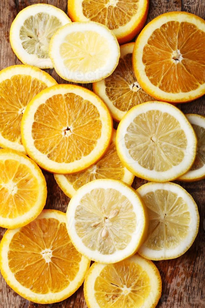 stack of citrus fruits slices. Oranges and lemons. photo