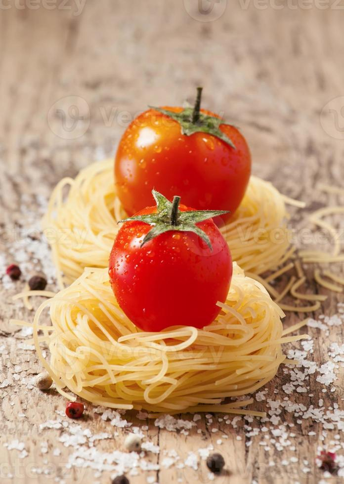 Fidellini dried pasta and fresh organic tomatoes photo