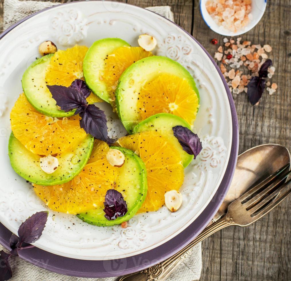 Appetizer of avocado and orange photo