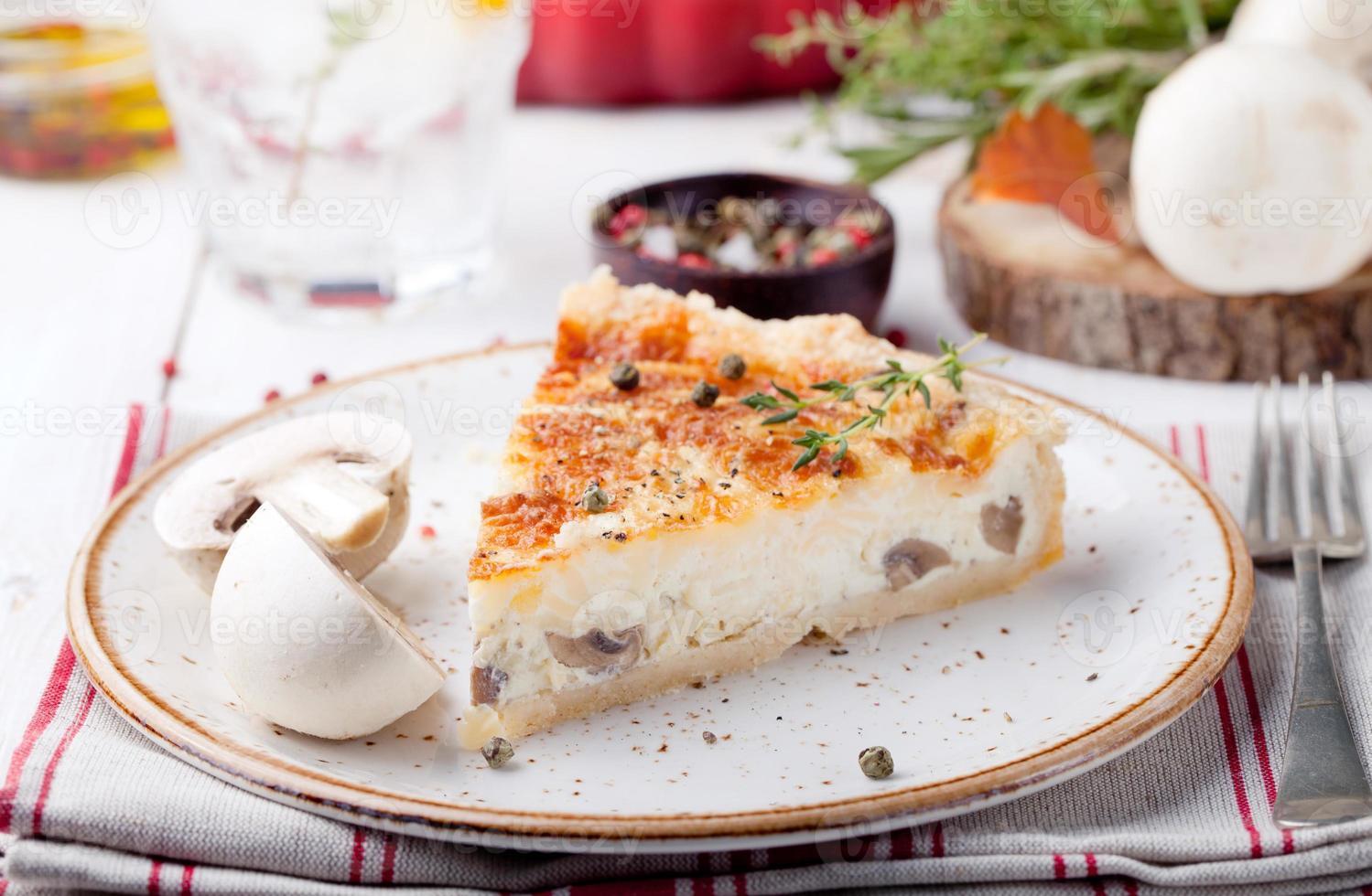 Mushroom, champignon pie, quiche slice on a ceramic plate photo
