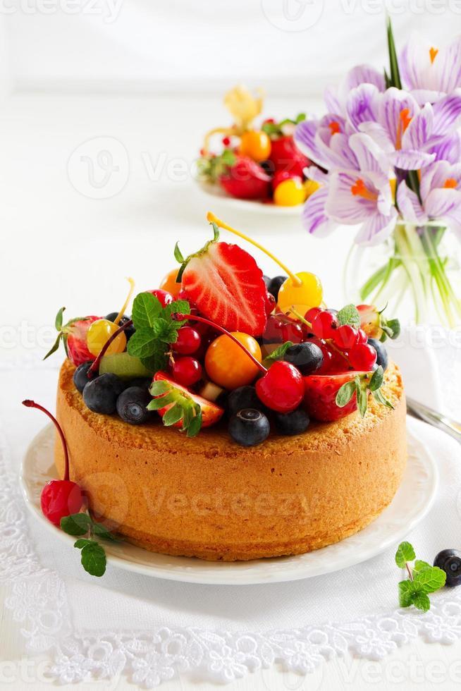 Chiffon cake with summer berries and cream. photo