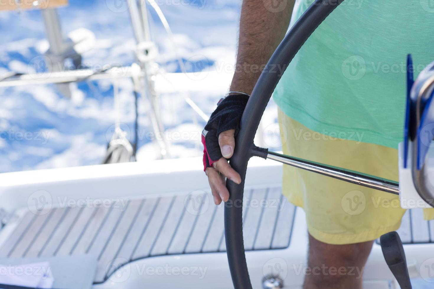 Steering a yatch - Stock Image photo