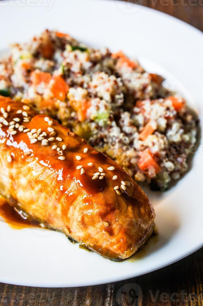 Baked salmon with couscous and vegetables photo