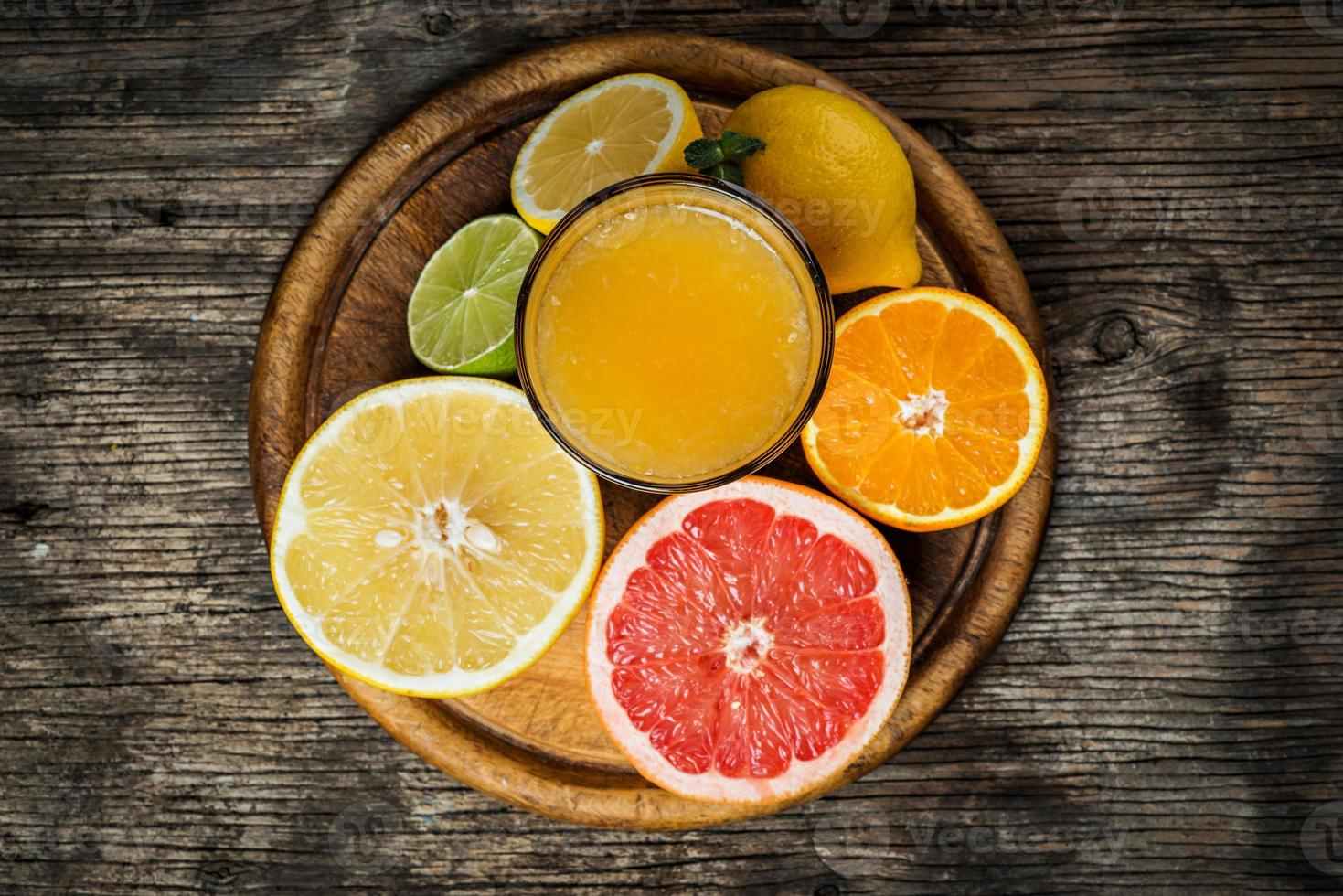 Citrus juice and fruits photo