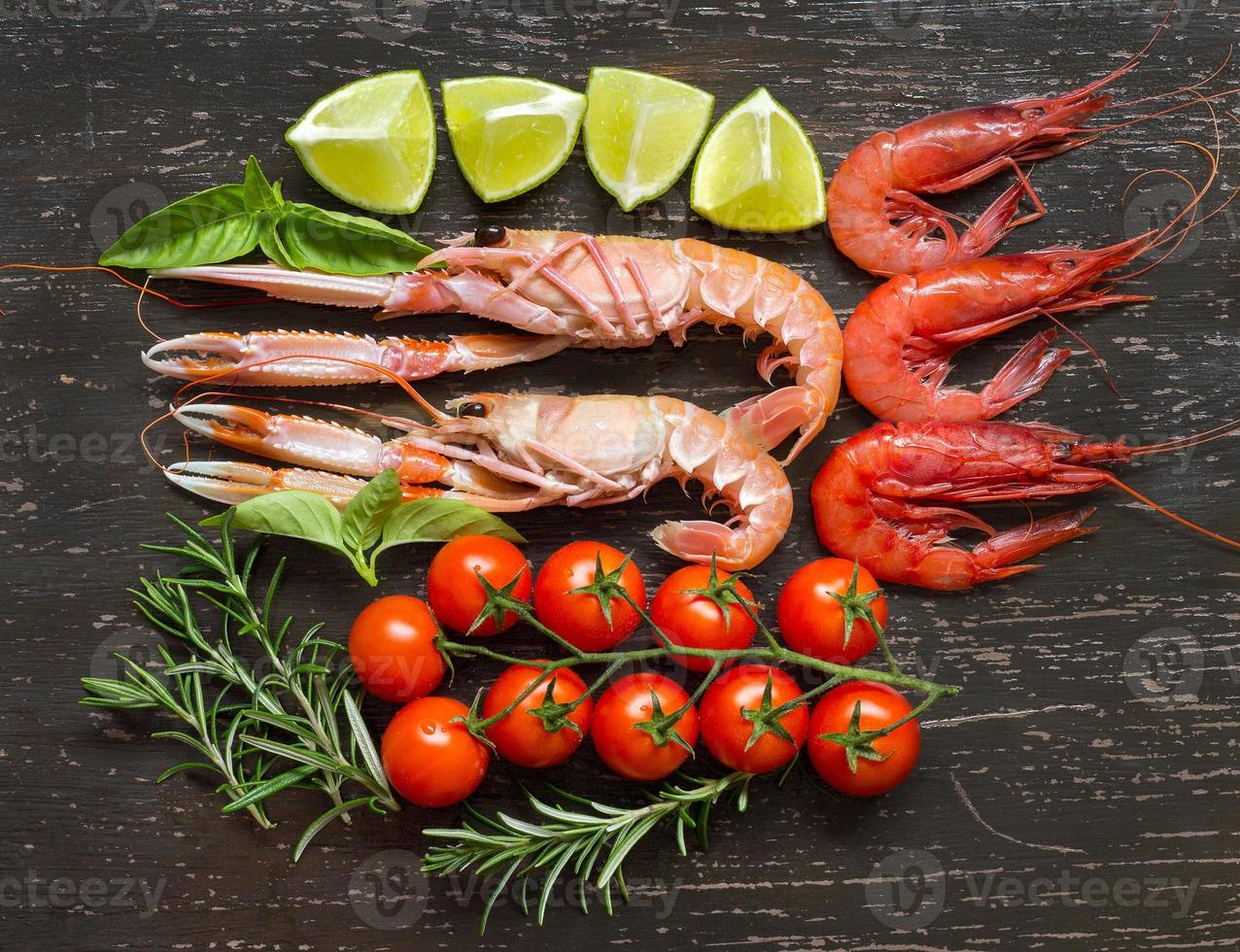 Raw langoustines and shrimps with vegetables photo