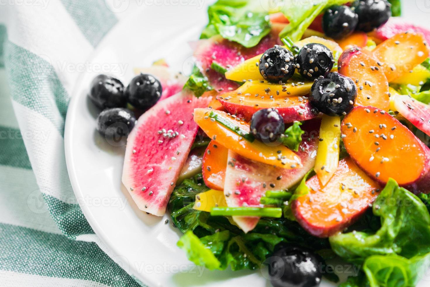 Summer salad with vegetables and berries photo