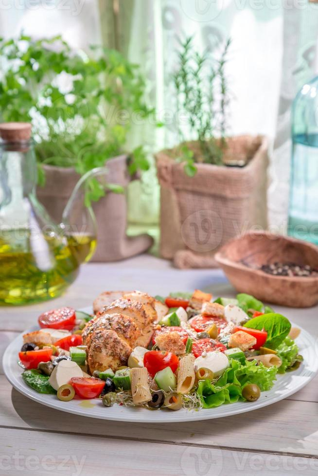 Caesar salad with fresh spring vegetables photo
