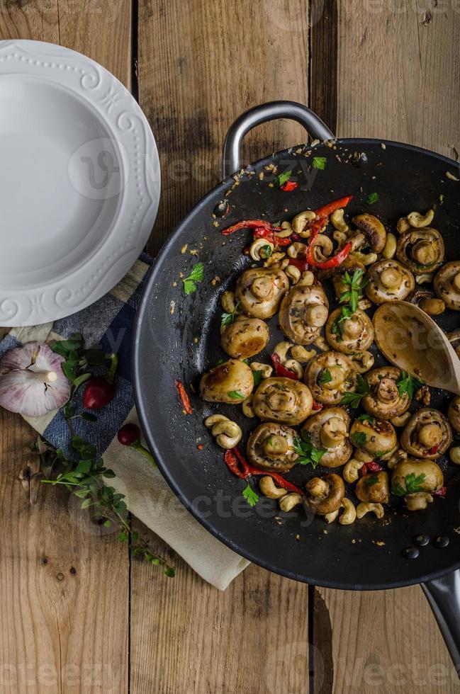 Fresh mushroom salad with chilli and herbs photo