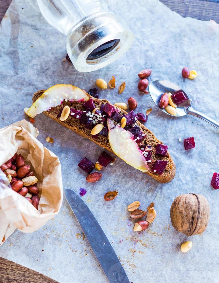 sandwich with roasted beets, nuts, pear and sesame photo