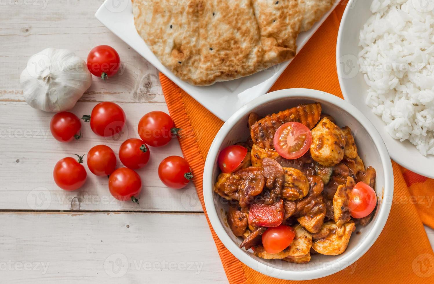 Indian chicken jalfrezi with basmati rice and naan photo