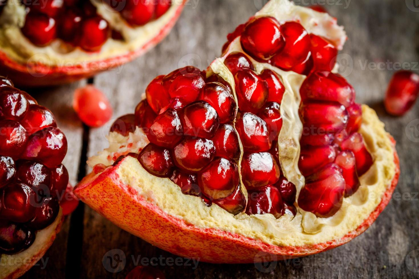 ruby juicy pomegranate grains closeup photo