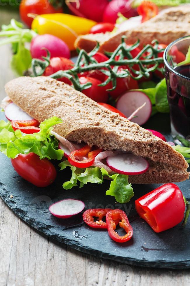 Sandwich with wholegrain bread and prosciutto photo
