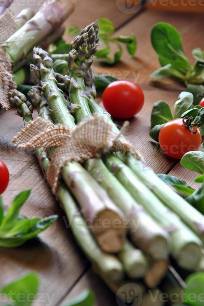 organic asparagus on wooden table photo