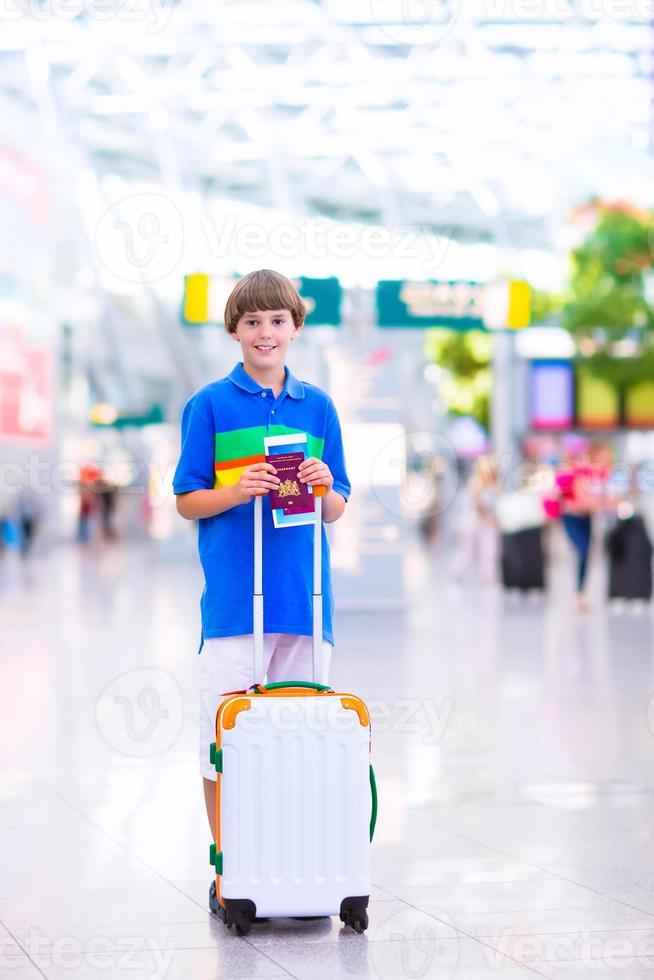Boy traveling by airplane photo